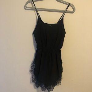 Black romper with lace trim
